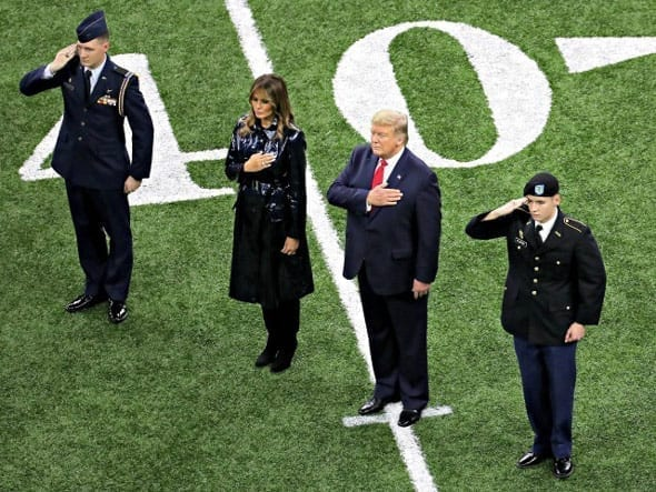 president trump and the first lady were met with thunderous applause from the patriotic football fans