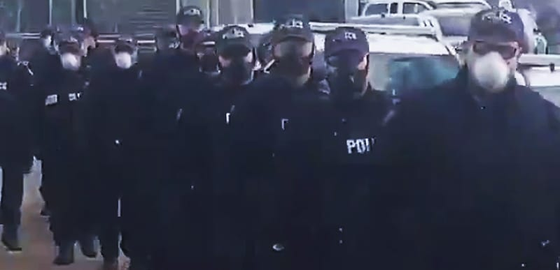 JAILED the pastor, STORMED the church, FENCED it off, now DOZENS of Covid TROOPS in gas masks raid worshippers OUTSIDE! [VIDEO]