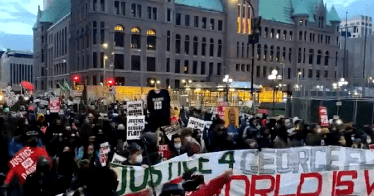 """WATCH: Minneapolis protesters chant """"National Guard go home!"""" hold banner that says """"The World is Watching"""""""