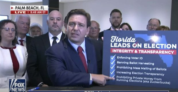 Gov DeSantis signs election integrity bill during interview on Fox News and here's what it does…