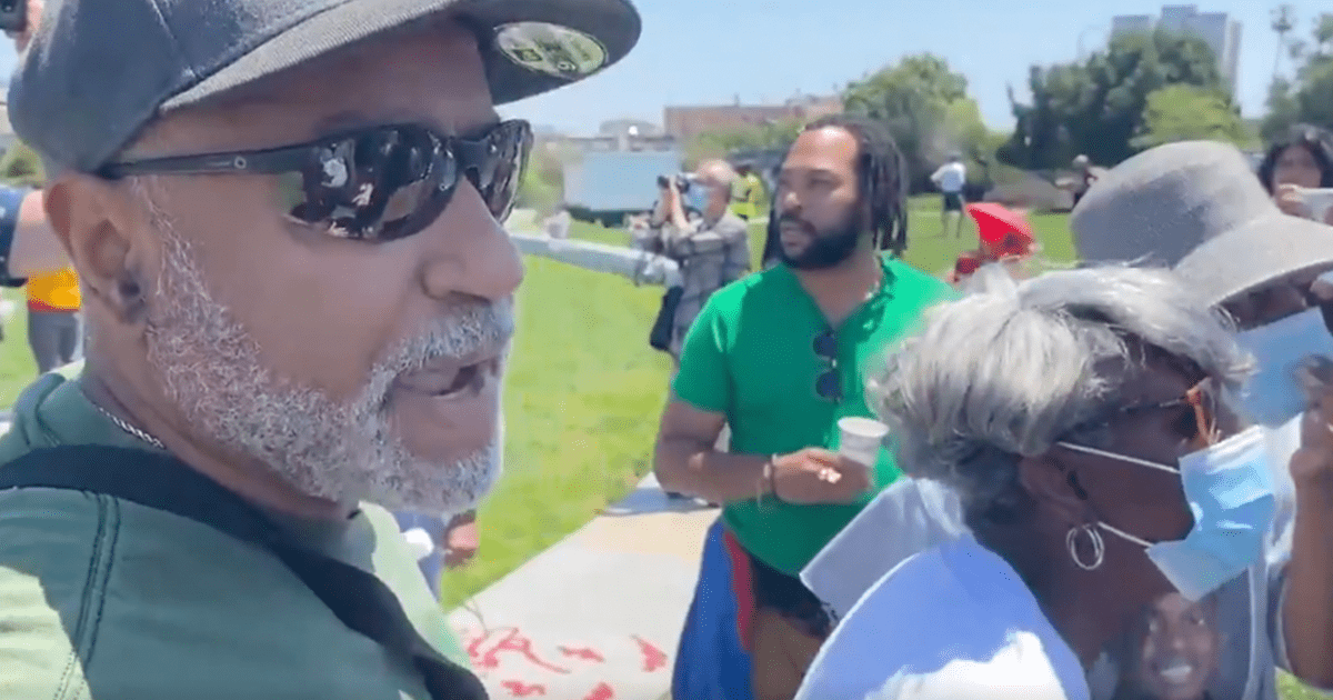 WATCH: Mostly black families in Oakland rally with police while white Antifa protesters jeer at them