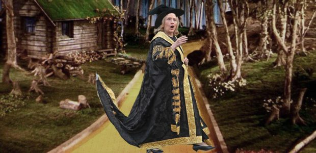 PERFECTION: Hillary Clinton BOOED, heckled at Queens Univ as her CAPE stretches WITCH-LIKE behind her.